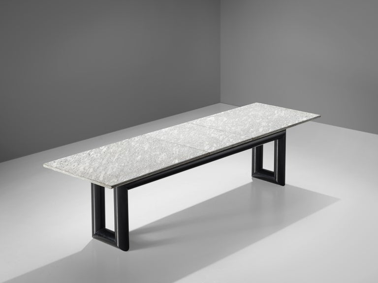 Mario Botta for Alias, dining table model 'Terzo', metal, granite, Italy, 1983  The 'Terzo' dining table features a long rectangular granite tabletop that consists of three parts andshows a beautiful sparkle and a play of different color shaded