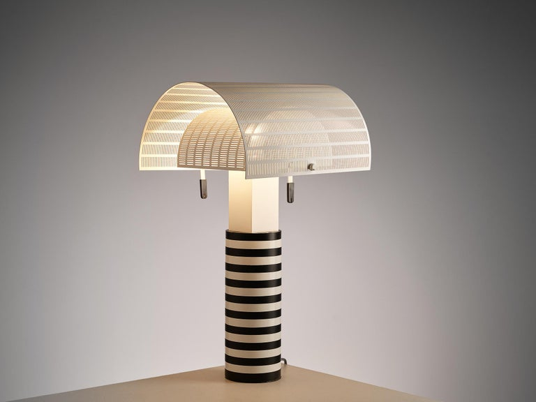 Mario Botta for Artemide, 'Shogun' table lamp, metal, Italy, 1986  A post modern table lamp by Mario Botta for Artemide. The cylindrical shaft is coated in black and white stripes. Two semi-circled, perforated diffusers can be adjusted to create