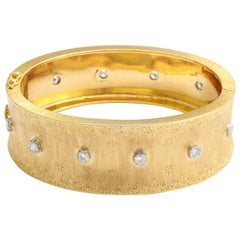 Mario Buccellati 18 Karat Yellow Gold and Diamond Bangle Bracelet, circa 1970s