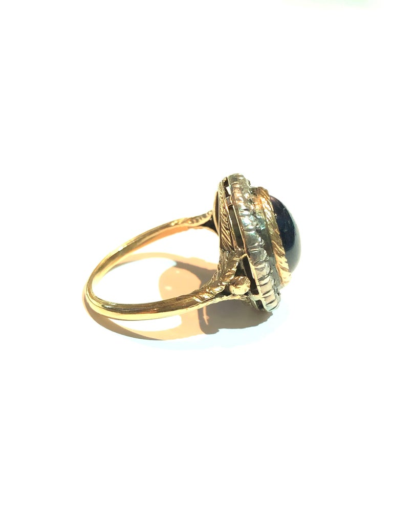 Mario Buccellati Ring made in 1929 for the italian poet Gabriele d'Annunzio who offered it to his wife, Carla.  The ring is in yellow gold, the top part in silver set with rose cut diamonds and on its center with a cabochon cur sapphire.  Comes in
