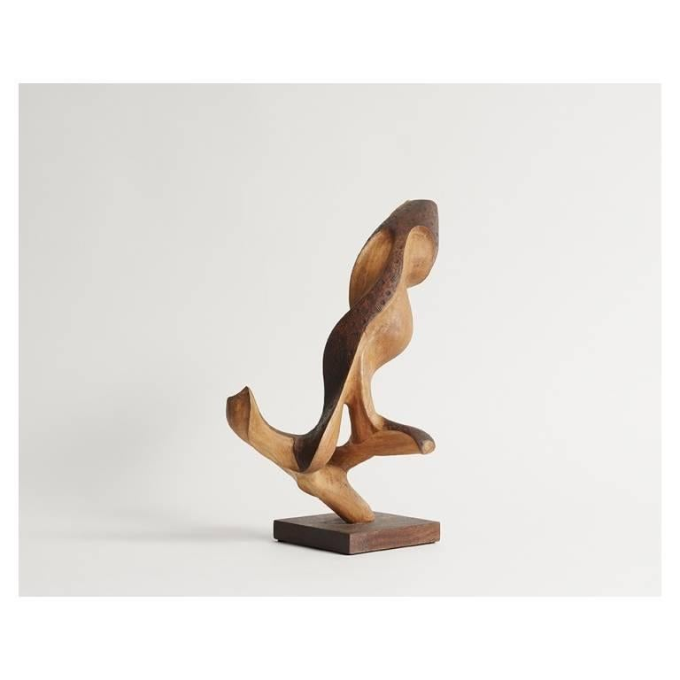 One of the more figural of dal Fabbro's oeuvre, this sculpture conjures images of a bird perched on a branch, ready to take flight. In the artist's classic style, however, the carving of this piece reveals the undulating forms, varying densities,