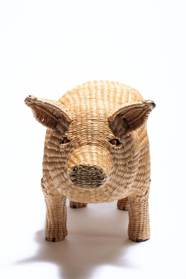 Fun Mario Lopez Torres wicker pig sculpture, Mexico 1970s. The pig features an iron frame with wicker woven over the frame and finished with copper eyes and an iron tail. Brass medallion on the underside includes the artist's name and reads