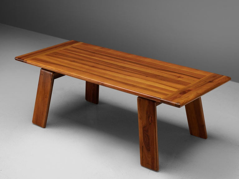 Mario Marenco for Mobilgirgi, 'Sapporo' dining table, walnut, Italy, 1970s  Geometric 'Sapporo' dining table in walnut by Mario Marenco. The four slanted legs are not directly connected to the angular tabletop, but connected to a supporting bar.