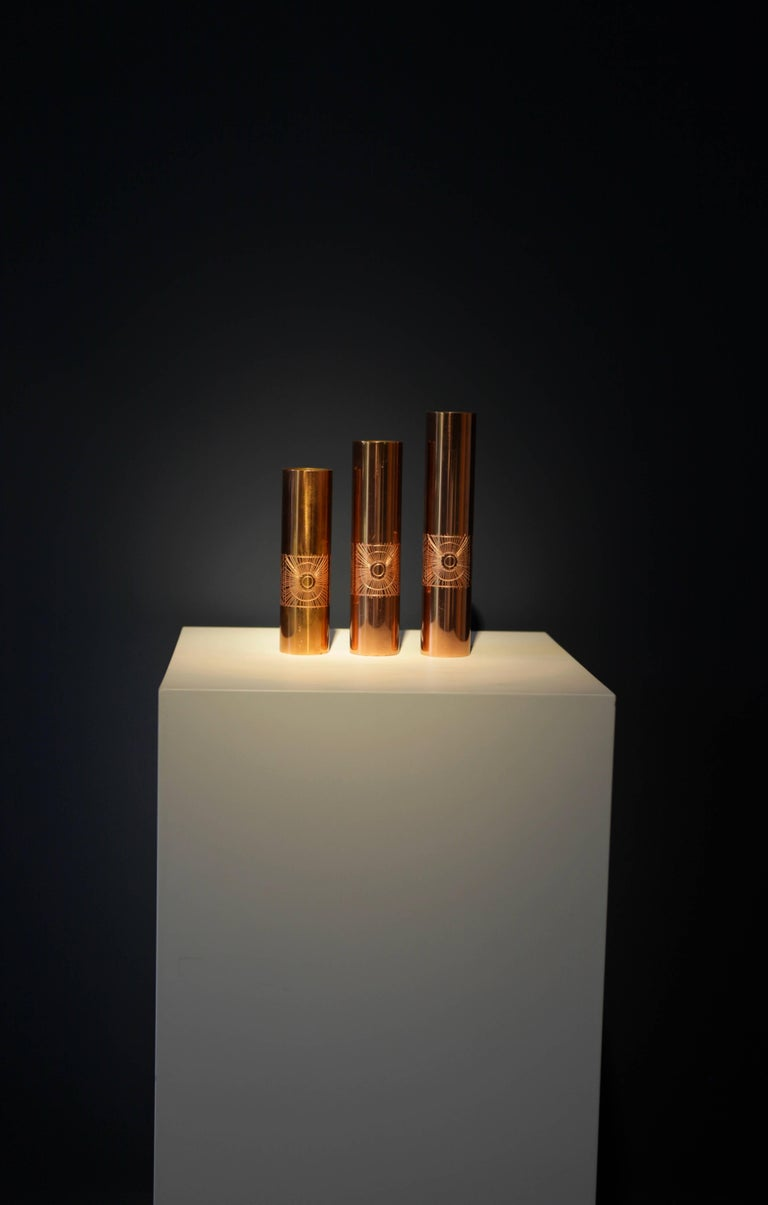 Unique artwork by Jeweler Mario Pinton (1919-2008) by three vases, Padova, Italy. Measures: 24.5cm, 21.5cm, 18.5cm, Ø 5cm. Made of copper Signed to the underside.