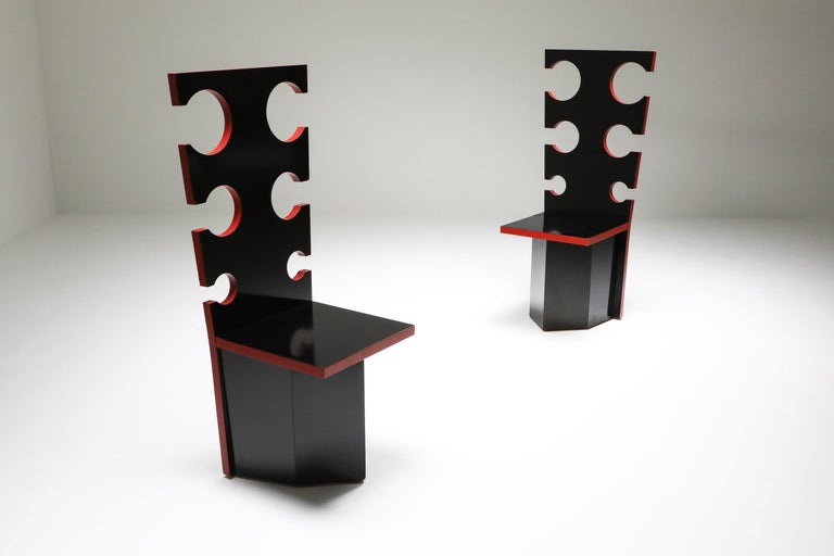 Black lacquer with red edges by Max Papiri, functional art, collectible design  Designed on request by and for the private home of Mario Sabot. The intriguing design shows straight cut-out backrests and rectangular seats on a polygonal base. The