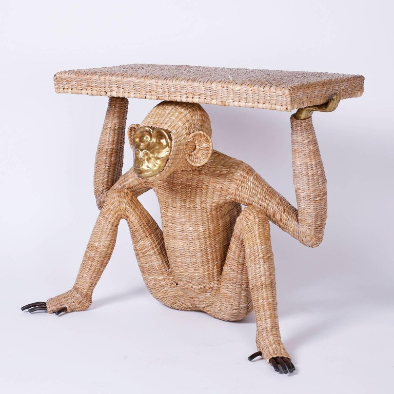 Mario Torres monkey or Chimpanzee console constructed with a metal frame expertly wrapped in wicker or reed. Having a pressed brass face and fingers and exposed toes. Labeled with a brass medallion Mario Lopez Torres Established 1974. Note that Mr.
