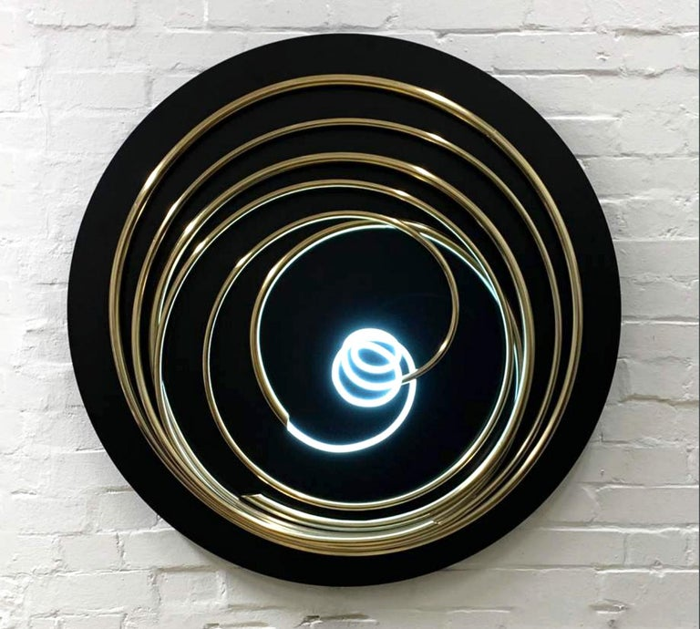 White Neon in Gold Spiral 100cm diameter x 13cm wall sculpture made of 24ct gold plated copper with white neon on painted steel disk. Very contemporary and elegant work of art with neon light at the centre.