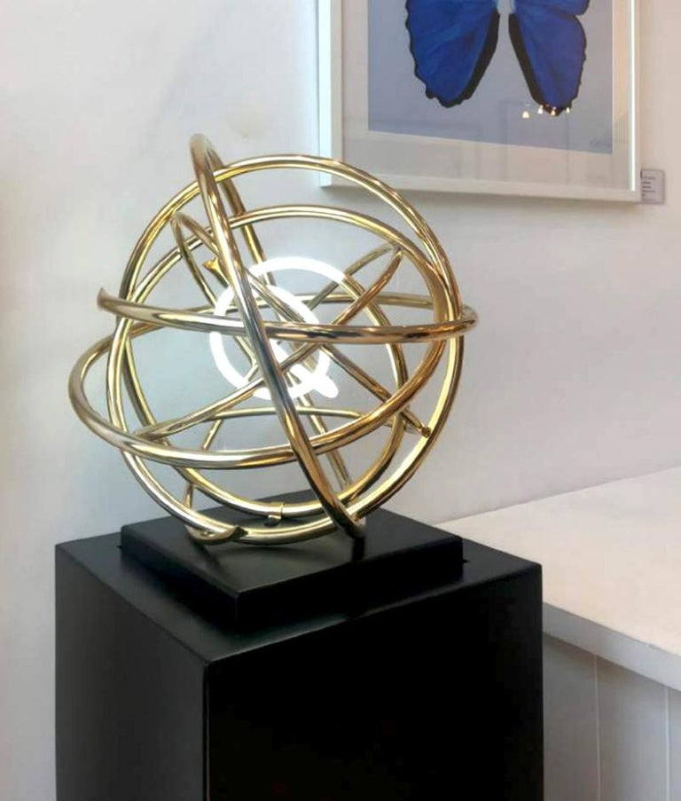 24ct gold plated copper and white neon on painted aluminium plinth  Working with various metals in all their contrasting properties of texture and finish, Mark can make industrial metal appear fluid, malleable and delicate. He continues to study
