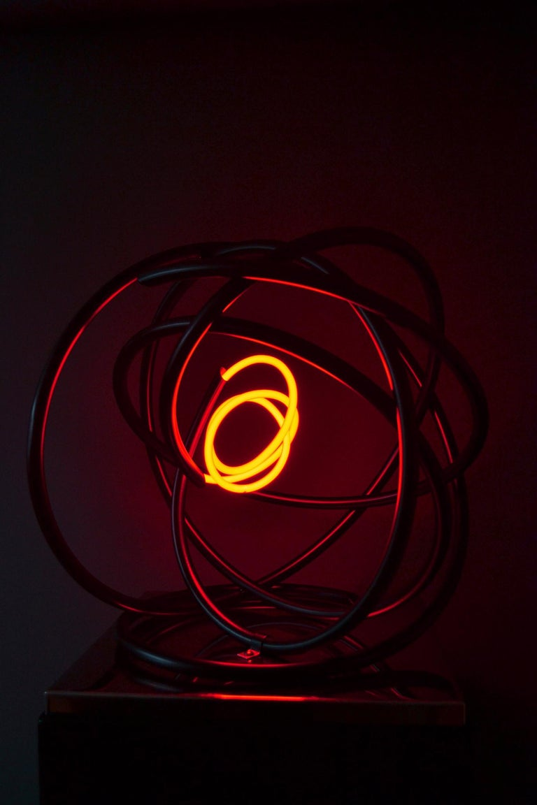 Small Red Neon Orb was first shown at London Art Fair 2018. The sculpture is mounted onto a mirror polished stainless steel plinth, which is perfect for displaying the piece on a table. Small Red Neon Orb also has a floor standing metal plinth, the