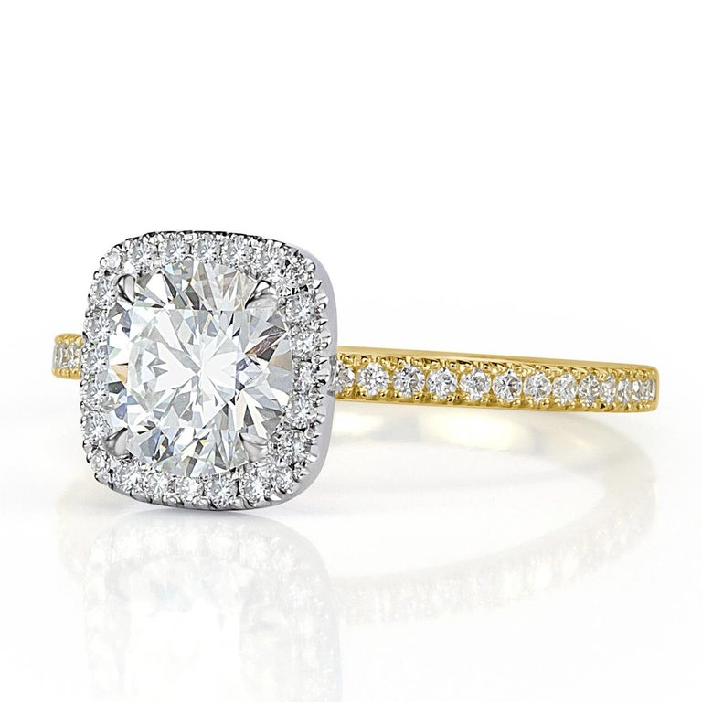 This gorgeous two-tone diamond engagement ring showcases a stunning 1.00ct round brilliant cut center diamond, GIA certified at H in color, VS2 in clarity. It displays tremendous brilliance due to its triple exellent grading in cut, polish and