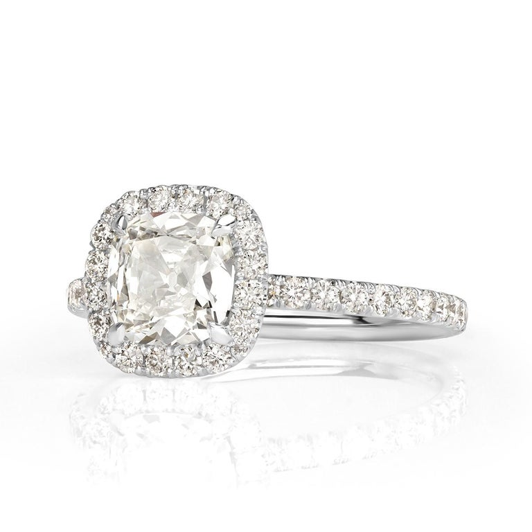 Custom created in platinum, this ravishing diamond engagement ring features a gorgeous 1.05ct old Mine cut center diamond, GIA certified at H in color, VS1 in clarity. It faces up peerless white, perfectly clear and has a tremendously beautiful cut.