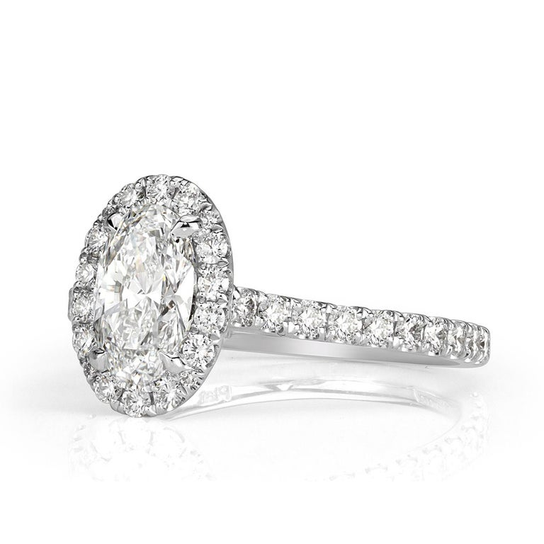 This exquisite diamond engagement ring showcases a beautiful 1.02ct oval cut center diamond, GIA certified at E in color, VS2 in clarity. It faces up a crisp white and measures an exceptional 8.34 x 5.15mm which make it look much larger than its