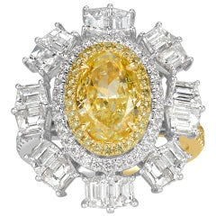 Mark Broumand 5.19 Carat Oval Cut Fancy Intense Yellow and White Diamond Ring