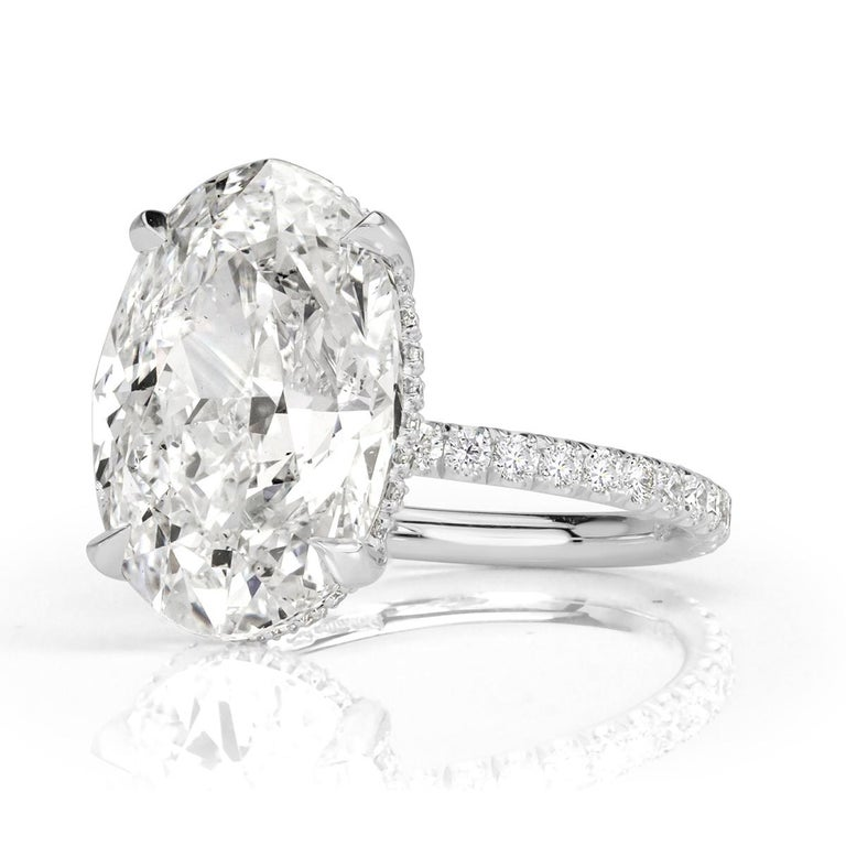 This magnificent diamond engagement ring showcases a breathtakingly beautiful 8.06ct oval cut center diamond, GIA certified at D in color, SI2 in clarity. It faces up intensely white and perfectly eye clean! It has exceptional measurements of 15.63