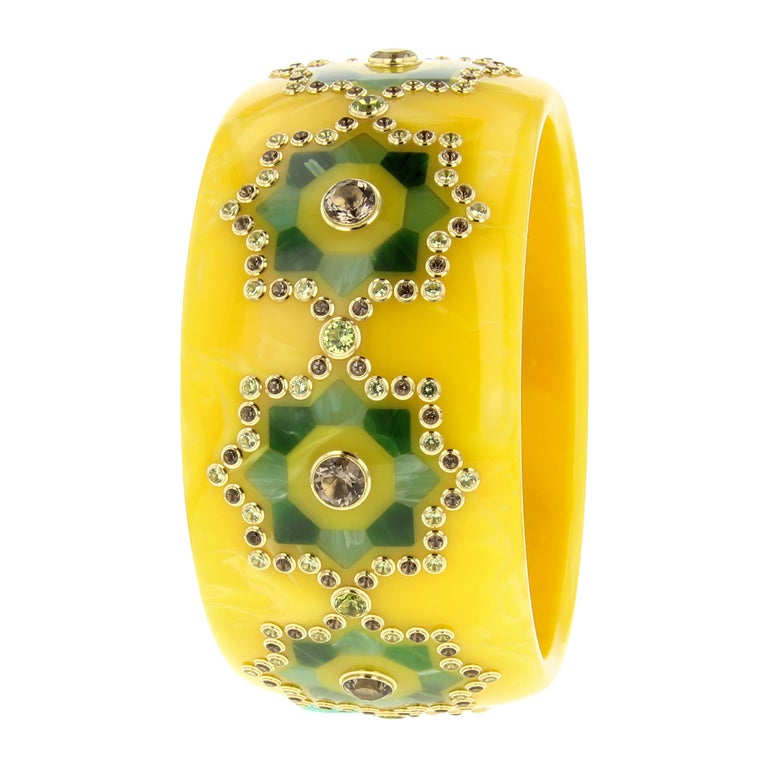 Mark Davis Bangle of Yellow Bakelite with Inlay, Peridot and Smoky Quartz For Sale