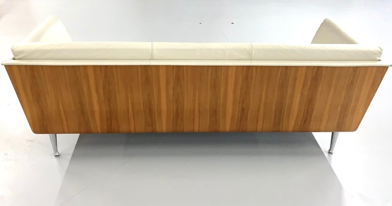 A beautiful sofa design by Mark Goetz for Herman Miller. It is an ivory color leather with a walnut frame. The sofa is finished on the back. Retains the original Herman Miller tag with a production date of 2002. In generally good condition with wear