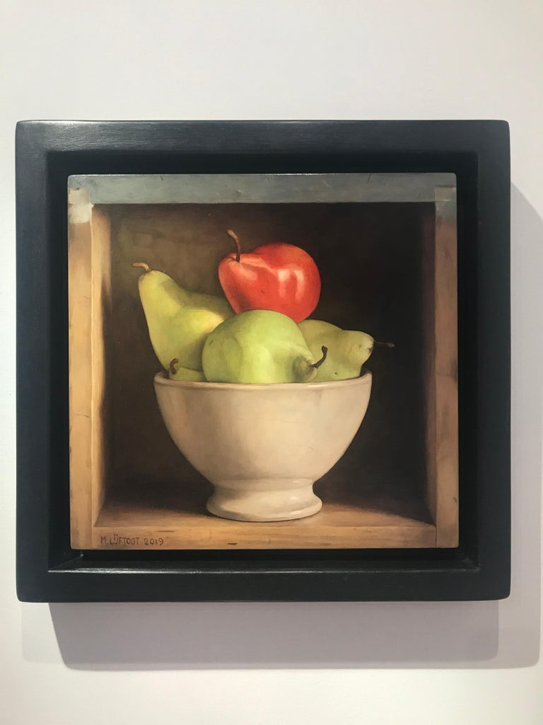 Colourful Still Life Realist painting of a 'Red & Green Pear' in a bowl  - Painting by Mark Lijftogt