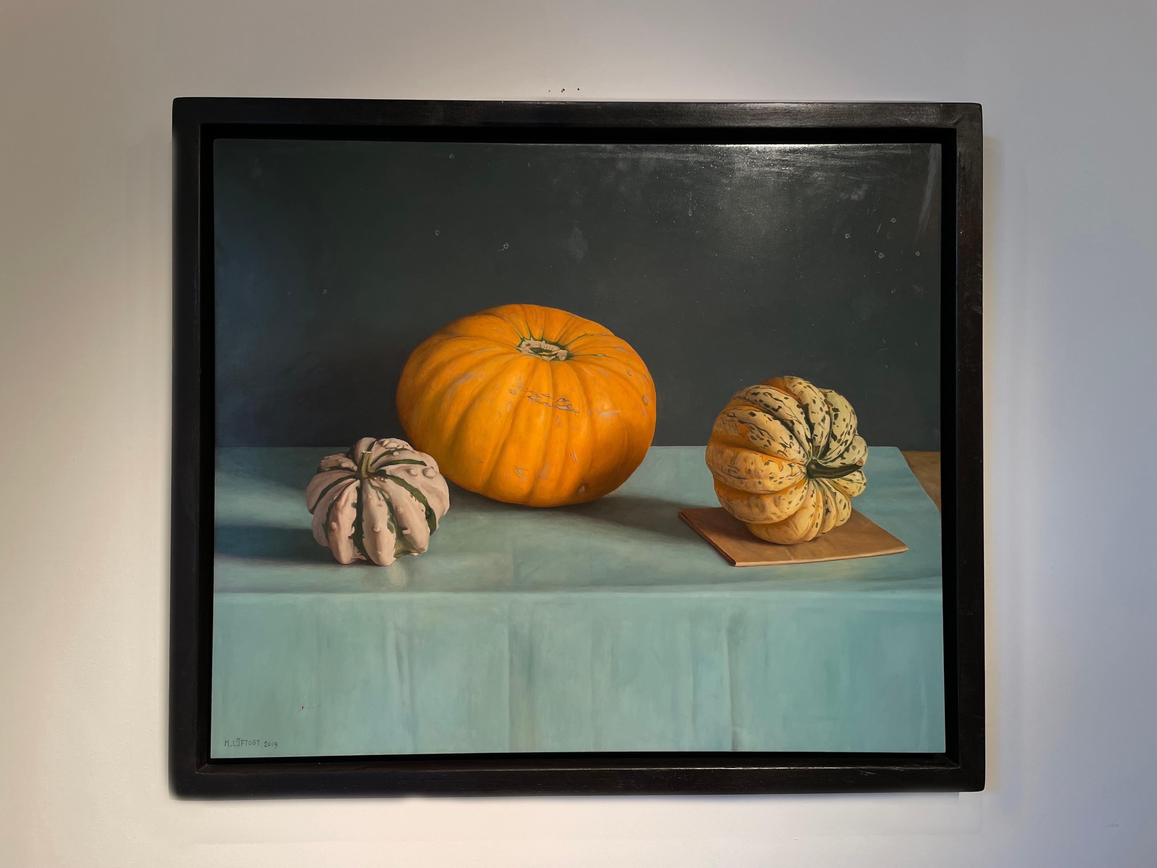 'Orange Pumpkin' Photorealist painting of pumpkins, on a blue, teal cloth