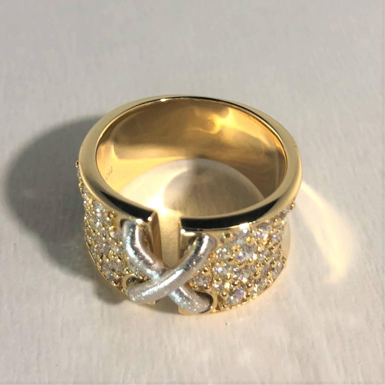 Mark Patterson 18 karat two tone gold and diamond Garter ring. This piece is created in 18 karat yellow and white gold and weighs 10.1 grams/ 6.6 dwt. A dual finish of polished metal. This ring shines bright with 34 full  cut round diamonds equaling