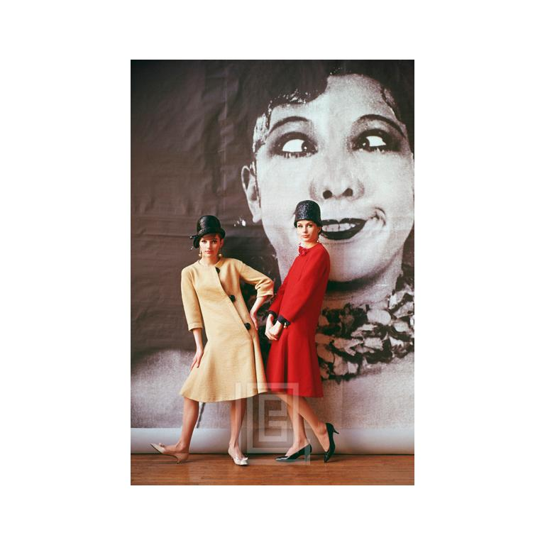 1920's Backdrop, Two Girls in Yellow and Red by Nina Ricci, 1961 - Photograph by Mark Shaw