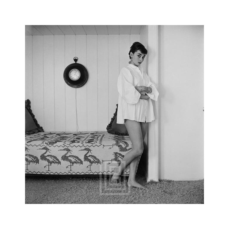 Mark Shaw Black and White Photograph - Audrey Hepburn at Home, Heron Day Bed, Arms Crossed, 1954