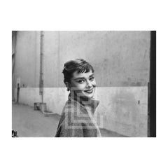 Audrey Hepburn in Grey Turtleneck Sweater, Glances Right Smiling, Head Tilted