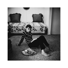 Audrey Hepburn in Striped Sweater Lounges, Arms Back, 1953