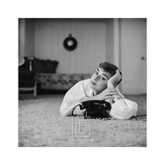 Audrey Hepburn in White Blouse with Phone, Head on Hand, Tilted, 1953