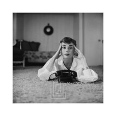 Audrey Hepburn in White Blouse with Phone, Laying, Fingers on Temples, 1953