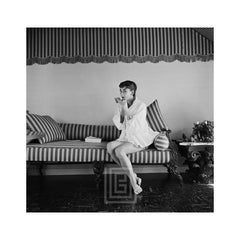 Audrey Hepburn on Striped Sofa, Applies Lipstick, 1954