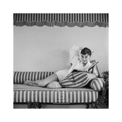 Audrey Hepburn on Striped Sofa, Arm Back, Smiling, 1954