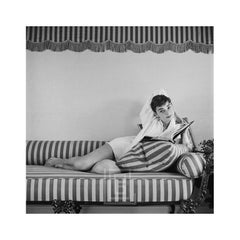 Audrey Hepburn on Striped Sofa, Elbow Behind Head, 1954