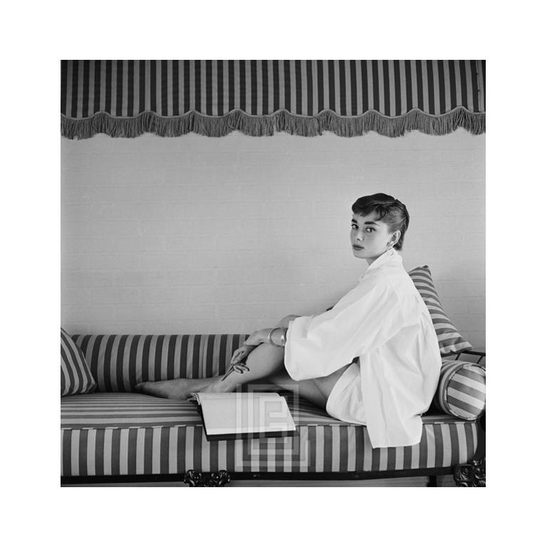 "Audrey Hepburn on Striped Sofa, r17_2 -- Audrey Hepburn at home. This image is an out take from the photo shoot for the cover of the April 19, 1954 international issue of Life magazine. Image size is 22"" x 22"" (for 24"" x 36"" paper size). All Mark"