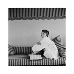 Audrey Hepburn on Striped Sofa, Hugs Knees, 1954