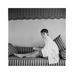 Audrey Hepburn on Striped Sofa, Leans Forward, 1954