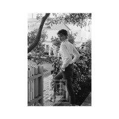Audrey Hepburn strolls in front of her Beverly Hills apartment, 1953