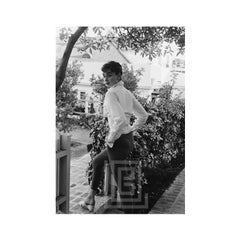 Audrey Hepburn strolls in front of her Beverly Hills apartment, Closer View