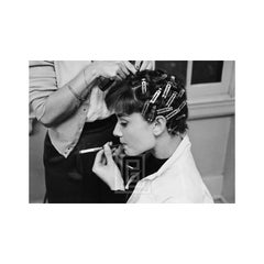 Audrey Hepburn with Curlers, Smoking, 1953
