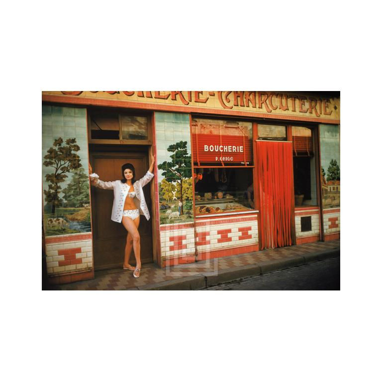 Mark Shaw Color Photograph - Christine visits the Boucherie in St. Tropez 1961