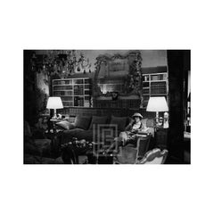 Coco Chanel Sits on Divan, 1957