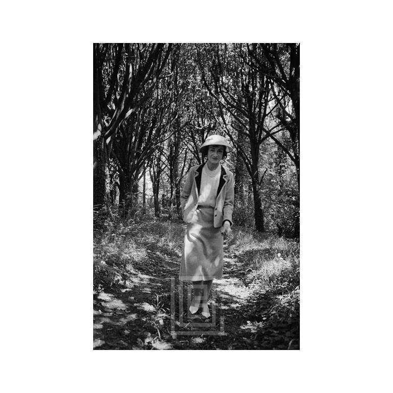Mark Shaw Black and White Photograph - Coco Chanel Strolls Alone, 1957
