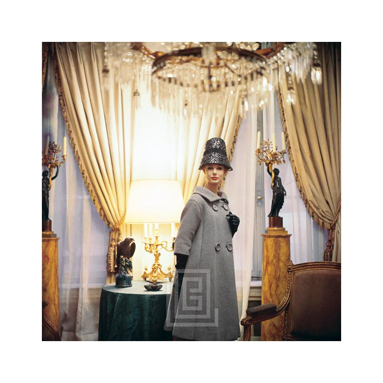"""Designer's Homes Bucket Hat -- Model Monique Chevalier in a Dior creation, photographed for 1960 issue of Life in the 17th century home of Suzanne Luling, Directrice of Dior. THE 24"""" x 36"""" SIZE OF THIS IMAGE IS ONLY OFFERED IN AN EDITION OF 15."""