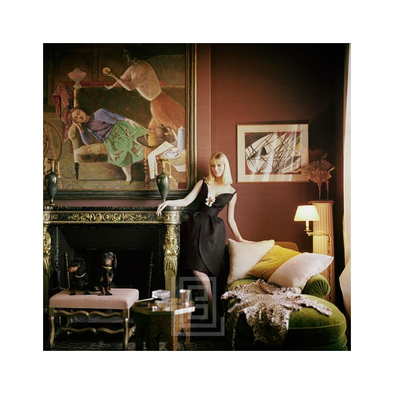Mark Shaw Color Photograph - Designer's Homes, Nico Stands with Dachshunds, Wears Dior, 1960