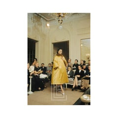 Dior Salon with Alla in Yellow Satin Artamene coat, 1954