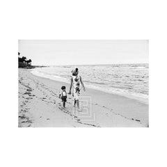 Kennedy, Jackie and John Jr. Walking on the Beach, 1963