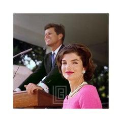 Kennedy, Jackie in Pink Dress, John at Podium