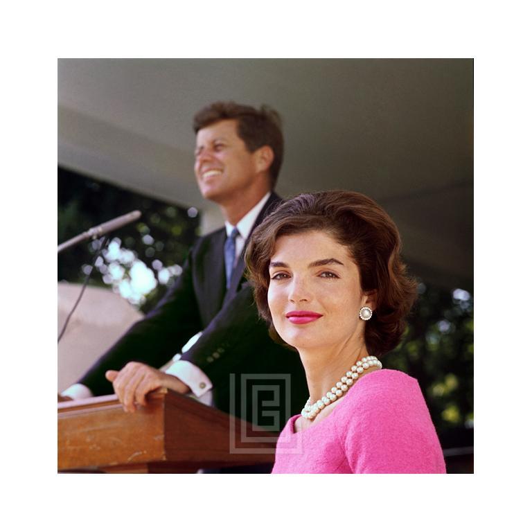 Kennedy, Jackie in Pink Dress, John at Podium 1