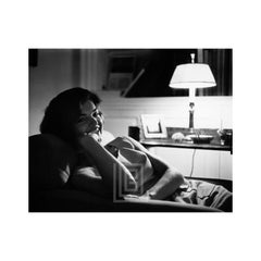 Kennedy, Jackie Relaxing by Lamp in Georgetown, 1959