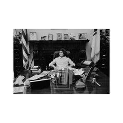 Kennedy, Jackie sits at JFK's Senate Desk, 1959