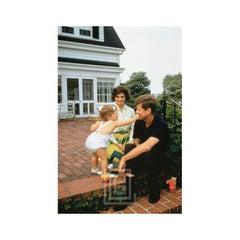 Kennedy, John F. and Jackie and Caroline on Patio, 1958